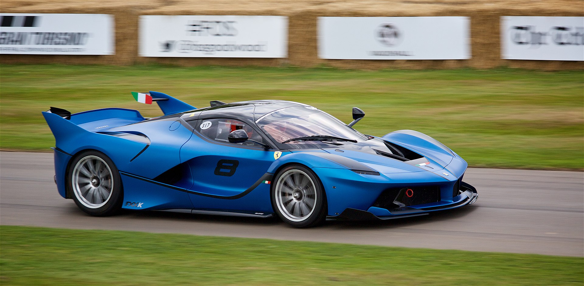 Ferrari FXX-K expensive car in blue on racetrack