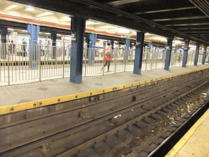 59th Street–Columbus Circle (New York City Subway) - Passageway between the two IRT Broadway–Seventh Avenue Line platforms via the center IND platform.