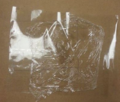 5 pieces of tape covered with cellophane layer.PNG