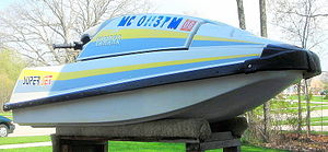 Watercraft - A vessel registration number (located near the top) on a Yamaha SuperJet
