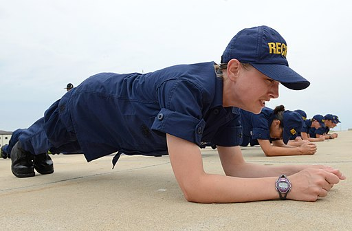 A U.S. Coast Guard recruit, assigned to Company Oscar 188, performs a plank during incentive training at Coast Guard Training Center Cape May in Cape May, N.J., July 31, 2013 130731-G-WA946-943