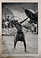 A Zulu medicine man or shaman performing a ritual to fend of Wellcome V0015961ER.jpg