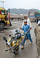 A boy pushes a wheelbarrow holding his possessions through the customs checkpoint at Torkham Gate in Nangarhar province, Afghanistan, April 24, 2013 130424-A-SW098-121.jpg