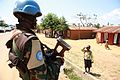 A child saluting and thanking a MONUSCO peacekeeper.jpg