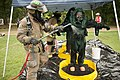 A firefighter, left, with the Tulsa Fire Department decontaminates a U.S. Soldier assigned to the 63rd Civil Support Team, Oklahoma National Guard during a training exercise at a farm near Verdigris, Okla 130621-Z-RH707-029.jpg