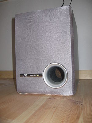 Bass reflex - A small JVC speaker with a port.