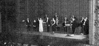"""Adaptations of Sherlock Holmes - Photograph of the debut broadcast of the radio series The Adventures of Sherlock Holmes, at NBC's Times Square studio on October 20, 1930. The episode, """"The Adventure of the Speckled Band"""", starred special guest William Gillette as Sherlock Holmes."""