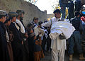 Afghan Local Police, assisted by coalition special operation forces, pass out cold weather materials and clothes to Afghan villagers in Nawbahar district, Zabul province, Afghanistan, Nov. 6, 2011 111106-N-AT856-003.jpg
