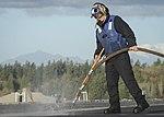 Airman cleans out padeyes 161103-N-DA275-073.jpg