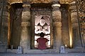 Ajanta Caves, India, Illuminated Buddha image inside ancient cave temple.jpg