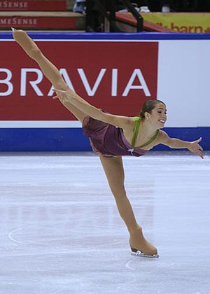 Alissa Czisny performs a spiral during her sho...