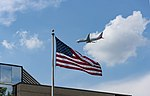 American N818NN on approach in front of an American flag 1.jpg