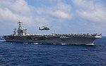 An MH-60S Seahawk helicopter flies past USS Dwight D. Eisenhower. (27966189456).jpg