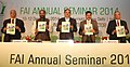 Ananthkumar and the Minister of State for Chemicals & Fertilizers, Shri Hansraj Gangaram Ahir releasing a publication at the inauguration of the Fertilizer Association of India annual seminar 2014 on 'Unshackling the.jpg