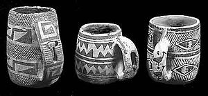 Mug - Ancestral Pueblo (Anasazi) mugs from SW Colorado, made between 1000 and 1280 CE. The meaning of the carving in the handles is yet unknown, but it is probably not functional.