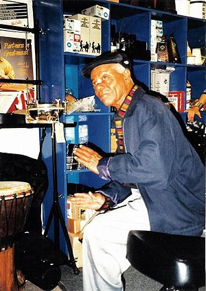 Armando Peraza - Armando Peraza playing a bongo in London, 1999