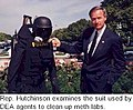 Asa Hutchinson examines the suit used by DEA agents to clean up meth labs.jpg