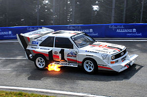 Back-fire - Flames bursting from the exhaust pipe of a 1985 Audi S1-E2 Quattro racing car during deceleration