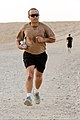 Australian Army Maj. Edward Sonan, assigned to the 2nd Cavalry Regiment Task Group, participates in the Sand to Sand charity run for Soldier On, an organization supporting wounded warriors, Aug. 17, 2013 130817-O-MD709-212-AU.jpg