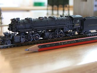 N scale - Model of an N scale 2-6-6-2 Mallet locomotive, shown alongside a pencil for size