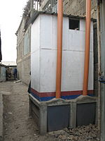 Back view of faeces vault of urine-diverting dry toilet (UDDT) in low-income area Bulbul near Nairobi, Kenya (10543126754).jpg