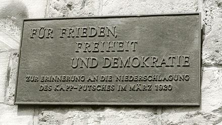 "Memorial for the suppression of the Kapp putsch, railway station of Wetter. The sign reads: ""For peace, freedom and democracy -- in memory of the suppression of the Kapp putsch in March 1920"" Bahnhof Wetter01 crop.jpg"