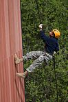 Bartlett Junior ROTC Cadet Dalyana Young, 14, rappels.jpg