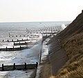 Battered by waves - the seawall below Corton Cliffs - geograph.org.uk - 1717913.jpg