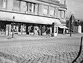 Belgrád (Ferenc József) rakpart - Fővám tér sarka, háttérben az 1. honvéd és népfölkelő gyalogezred emlékműve a Fővám téren. Fortepan 3322.jpg