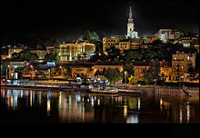 Belgrade at night, reflected in a river