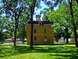 Belleville, Wisconsin - Library Park, with the old Village Hall (1894) in its center, is listed on the National Register of Historic Places