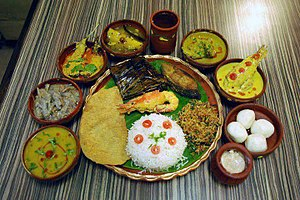 Bengali Hindus - Various Bengali fish and seafood served with rice and dessert