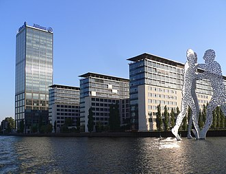 """Alt-Treptow - The building complex """"Treptowers""""   and the sculpture """"Molecule Man"""""""