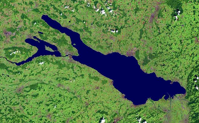 "Satellite image. In the center and on the right (i.e. to the east) the larger part of Lake Constance, called the Obersee, is visible, and it includes, in the lower right, the Delta of the Alpine Rhine. The northwesterly ""finger"" (on the top left) is Lake Uberlingen, containing the island of Mainau. Below Lake Uberlingen (also in the west) is the smaller Untersee, containing Reichenau Island. The Obersee and Untersee are connected by the four kilometers long Seerhein. On the left the High Rhine can be seen. Bodensee satellit.jpg"
