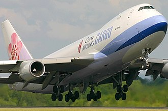 Economy of Manchester - China Airlines Cargo Boeing 747-400F departs Manchester Airport