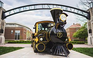 Boilermaker Special - The Boilermaker Special, the Official Mascot of Purdue University, stands parked underneath the Gateway to the Future Arch.