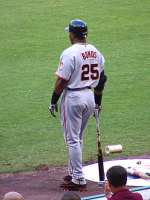 Batting (baseball) - Barry Bonds in the on deck circle with various warm up devices.