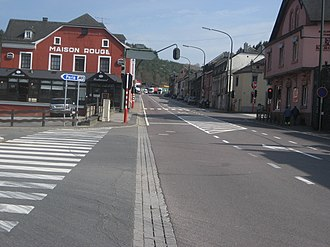 Martelange - The street itself and the houses on the right side belong to Belgium, the red house and all the gas stations are on Luxembourg territory.