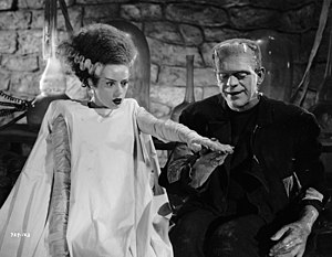 Bride of Frankenstein - Elsa Lanchester and Boris Karloff in Bride of Frankenstein. The bride's conical hairdo, with its white lightning-trace streaks on each side, has become an iconic symbol of both the character and the film.
