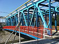 Bridge, river, wire fence, factory, Zlín.JPG