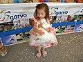 Bucharest, Romania. ROMEXPO. Exhibition of hens. 2018. A little girl loves a white han. (2).jpg