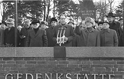 Victor IV (right of centre) announcing his abdication at the Royal Memorial Cemetery on 28 October 1989, a critical moment during the revolution