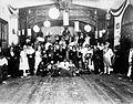 COLLECTIE TROPENMUSEUM Groepsportret tijdens een gemaskerd bal in de Club te Lebong Donok TMnr 60034540.jpg
