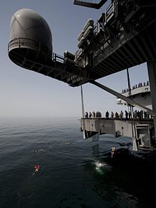 CVN-70-120323-N-DR144-596 ARABIAN SEA (March 23, 2012) Sailors jump off aircraft elevator No. 4 uring a swim call aboard the Nimitz-class aircraft carrier USS Carl Vinson (CVN 70).JPG