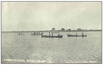 Wascana Centre - Canoeing on Wascana Lake, pre-1905 when weir was 1½ blocks west of present location and lake larger: Note farm buildings on the future site of the provincial legislative building