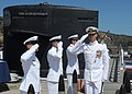 Cmdr. Trent Hesslink departs the Los Angeles-class attack submarine USS Albuquerque (SSN 706) following a change of command ceremony.JPG