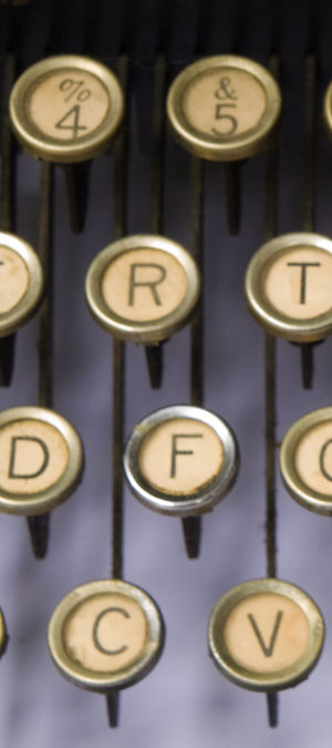 QWERTY - Keys are arranged on diagonal columns, to give space for the levers.