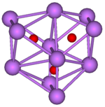 The stick and ball diagram shows three regular octahedra which are connected to the next one by one surface and the last one shares one surface with the first. All three have one edge in common. All eleven vertices are purple spheres representing caesium, and at the center of each octahedron is a small red sphere representing oxygen.