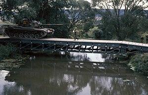 Medium Girder Bridge - An M60A3 main battle tank crosses a medium girder bridge during Exercise REFORGER '83 in Germany, 1983