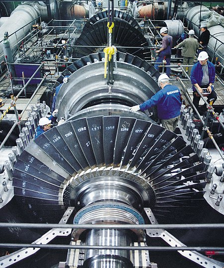 A steam turbine with the case opened. Such turbines produce most of the electricity used today. Electricity consumption and living standards are highly correlated. Electrification is believed to be the most important engineering achievement of the 20th century. Dampfturbine Montage01.jpg